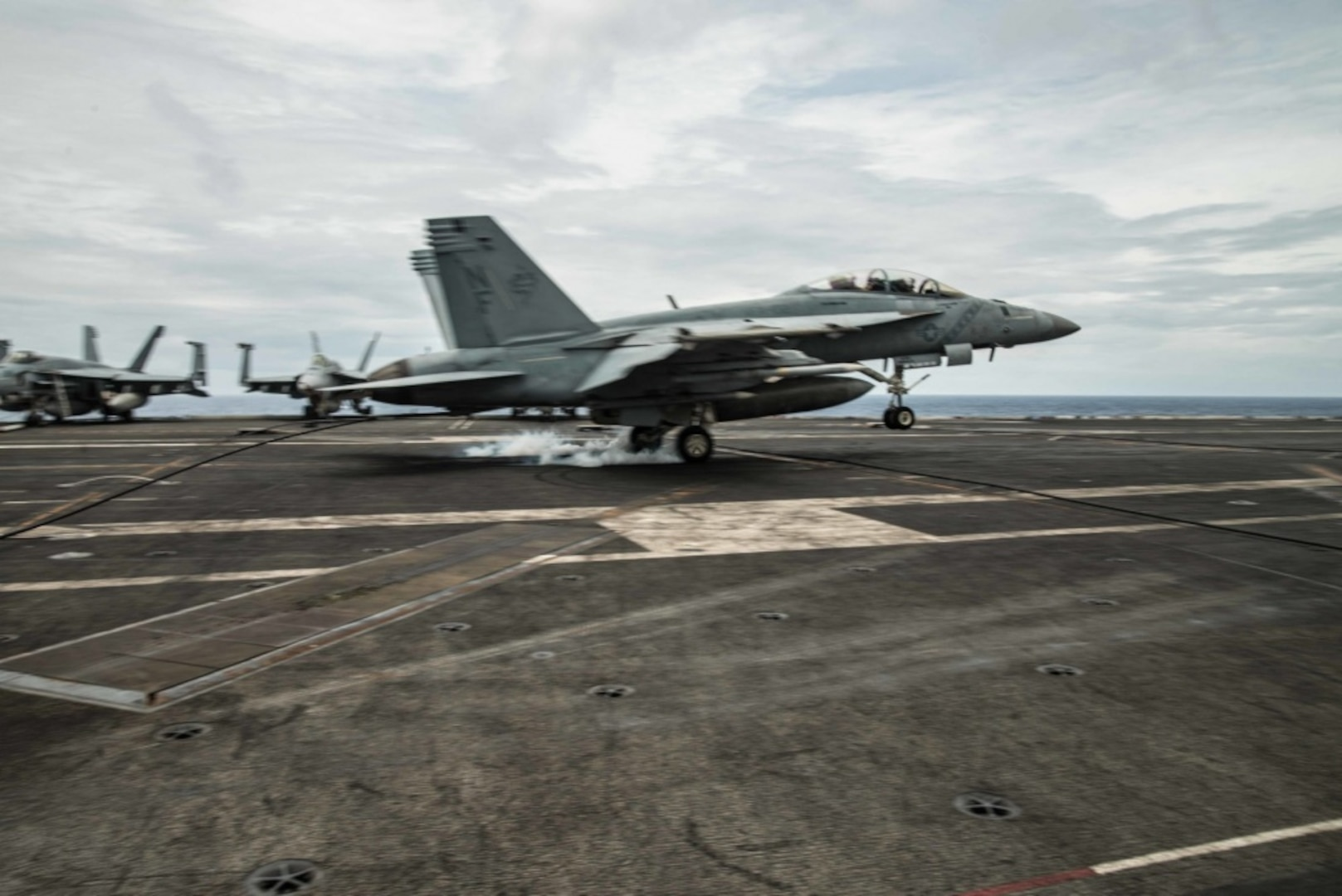 SOUTH CHINA SEA (August 6, 2019) An F/A-18F Super Hornet, piloted by Cmdr. Harry Evans, commanding officer of Strike Fighter Squadron (VFA) 102, lands on the flight deck of the Navy™s forward-deployed aircraft carrier USS Ronald Reagan (CVN 76). This was Evans™ 1,000th arrested carrier landing. Ronald Reagan, the flagship of Carrier Strike Group 5, provides a combat-ready force that protects and defends the collective maritime interests of its allies and partners in the Indo-Pacific region.