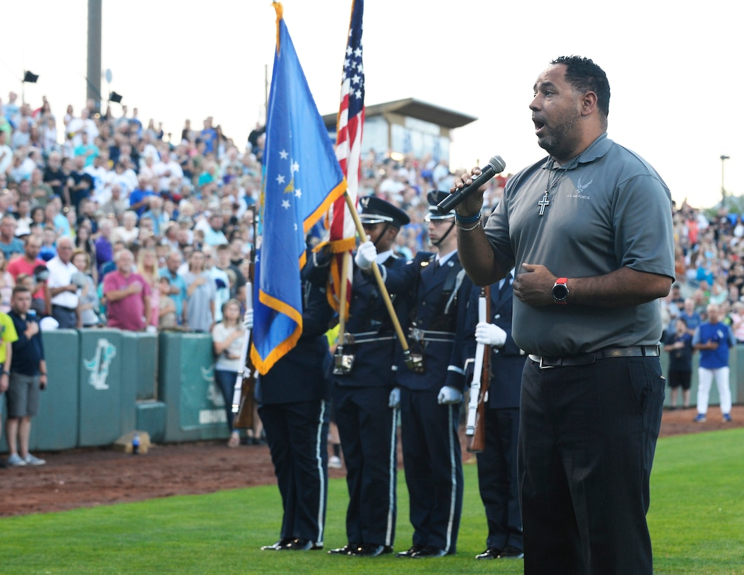 Retired Air Force Staff Sgt. De Andre Boyd sings the national anthem  Aug. 9, 2019, before Military Appreciation Night with the Ogden Raptors and Idaho Falls Chuckars at Lindquist Field in Ogden, Utah. Each year, the Raptors team up with the Top of Utah Military Affairs Committee to offer tickets to Hill Air Force Base personnel and their families. (U.S. Air Force photo by David Perry)