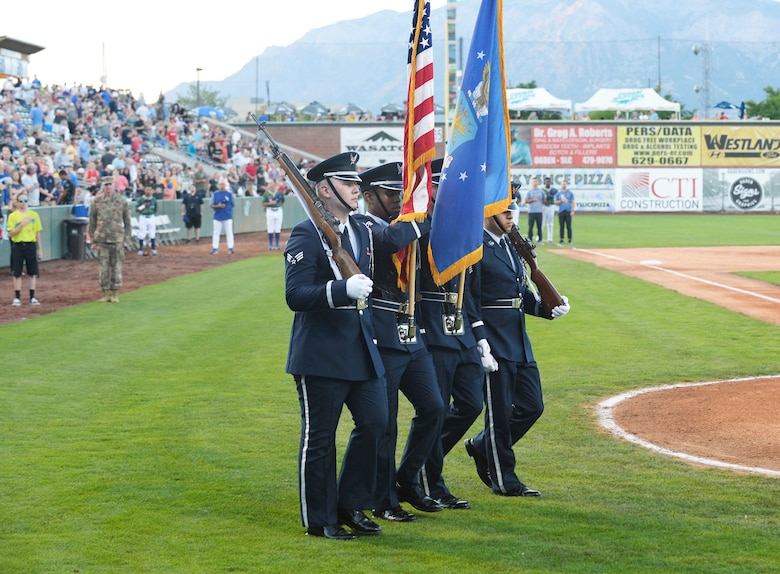 The Hill Air Force Base Honor Guard marches onto the field to present the colors during the Aug. 9, 2019, Military Appreciation Night with the Ogden Raptors and Idaho Falls Chuckars at Lindquist Field in Ogden, Utah. Each year, the Raptors team up with the Top of Utah Military Affairs Committee to offer tickets to Hill Air Force Base personnel and their families. (U.S. Air Force photo by David Perry)