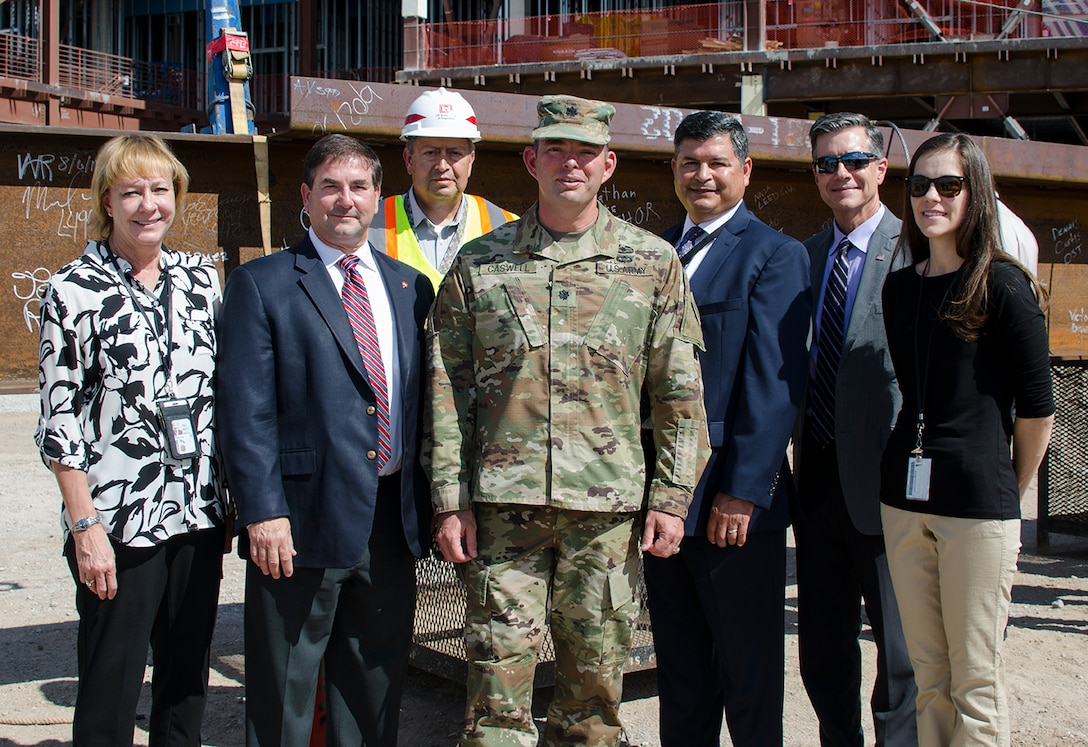 """ALBUQUERQUE, N.M, - Several members of the U.S. Army Corps of Engineers attended the """"Topping Out"""" celebration at the National Nuclear Security Administration Albuquerque Complex, August 6. (L to R) Kathy Mayer, supervisory contracting specialist; John Drake, deputy district engineer, project management; Michael Guerin, chief, Engineering and Construction, Lt. Col. Dale Caswell, Albuquerque District commander; John Moreno, regional business director, South Pacific Division, USACE; Michael Goodrich chief, military and IIS project management, Albuquerque District; and Michelle Kessinger, contract specialist, Albuquerque District."""
