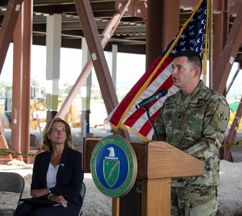 "ALBUQUERQUE, N.M. - Hon. Lisa Gordon-Haggerty, National Nuclear Security Administration Administrator, listens to Lt. Col. Dale Caswell, commander, U.S. Army Corps of Engineers, Albuquerque District, during a ""Topping Out"" celebration at the NNSA Albuquerque Complex, August 6. ""This new NNSA state-of-the-art facility is an investment in the security of the nation. This facility is important in the critical support of infrastructure for the modernization of our nuclear programs,"" said Caswell."" The celebration marked the placing of the final steel beam on the building. The facility is scheduled for completion in November 2020."