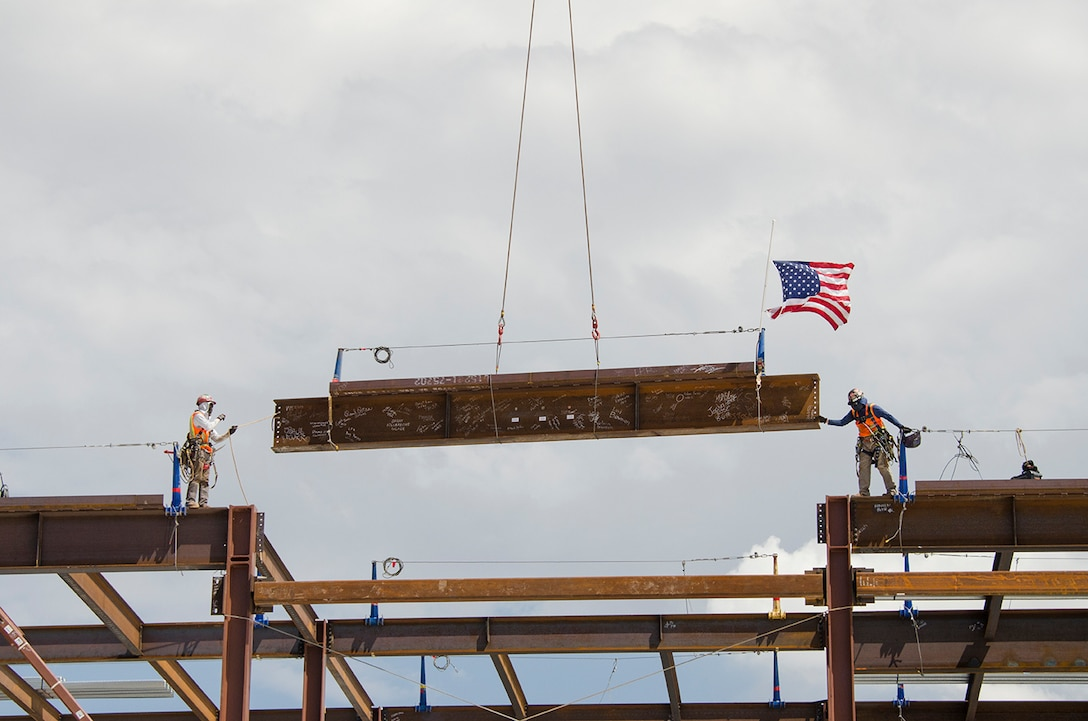 "ALBUQUERQUE, N.M. - Steelworkers prepare to install the last steel beam as it is lifted into place during a ""Topping Out"" celebration at the National Nuclear Security Administration Albuquerque Complex, August 6. The event celebrated the emplacement of this last steel beam, a milestone in completing the structure. Lt. Col. Caswell, commander, Albuquerque District; Lisa Gordon-Haggerty, administrator, NNSA; Jeff Caddell, contractor for the project, and many other participants also had the opportunity to sign the beam prior to placement."