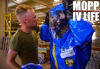 U.S. Marine Corps Lance Cpl. Phoenix Drohan, left, assists Sgt. Cesar Quintero in putting on his Level-A fully encapsulated chemical protective suit at Camp Kinser, Okinawa, Japan, August 1, 2019. The suit provides the highest level of protection against unknown threats and protects wearers from substances known to damage lungs, skin and eyes. Drohan, a native of San Diego, California, and Quintero, a native of Odessa, Texas, are both CBRN defense specialists with G-3, Enhanced CBRN Section, Combat Logistics Regiment 37, 3rd Marine Logistics Group. (U.S. Marine Corps photo by Lance Cpl. Carla E. O)