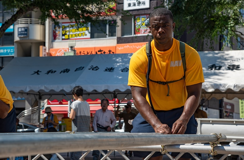 YAMATO, Japan (Aug. 09, 2019) Legalman 1st Class Ryan Pickens, from Kaufman, Texas takes part in assembling the Yagura stage for Yamato city's annual Yamato Furusato summer festival. The festival featured dance routines performed by members of the local community as well as Naval Air Facility Atsugi's Bon Odori dancers.