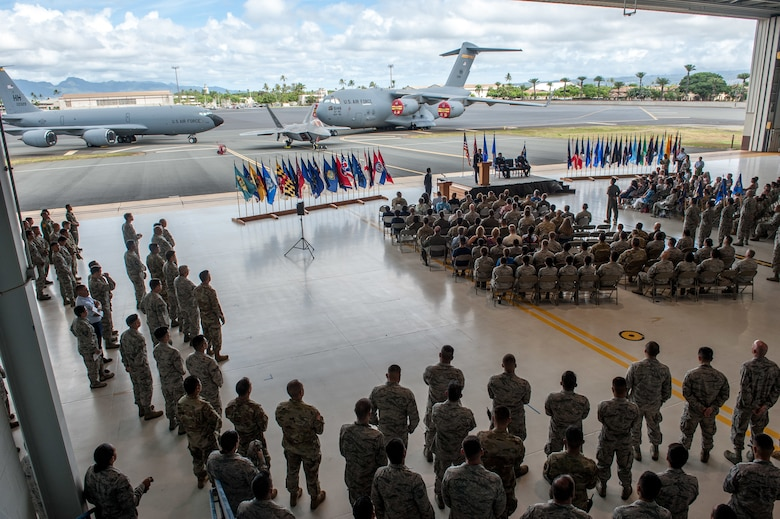 Members of the 154th Wing gather for a change of command ceremony Aug. 4, 2019, at Joint Base Pearl Harbor-Hickam. During the event, Col. Dann S. Carlson assumed command of the Hawaii Air National Guard's 154th Wing from Brig. Gen. Gregory Woodrow.