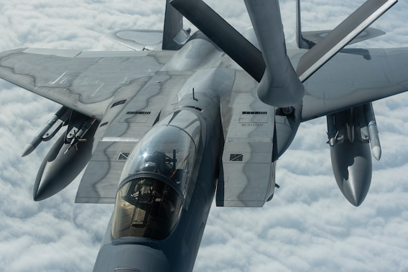 A 67th Fighter Squadron F-15C Eagle and 909th Air Refueling Squadron KC-135 Stratotanker, both from Kadena Air Base, Japan, conduct aerial refueling during RED FLAG-Alaska 19-3 at Eielson Air Force Base, Alaska, Aug. 7, 2019.