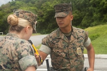 U.S. Marine Corps Lance Cpl. Samuel Mendoza, a military policeman with Marine Corps Installations Pacific-Marine Corps Base (MCIPAC-MCB) Camp Smedley D. Butler Provost Marshal's Office (PMO), conducts a simulated sobriety check at Camp Foster, Okinawa, Japan, Aug. 7, 2019. MCIPAC-MCB PMO began implementing random field sobriety checks in accordance with Marine Corps Base Butler Bulletin 5560.