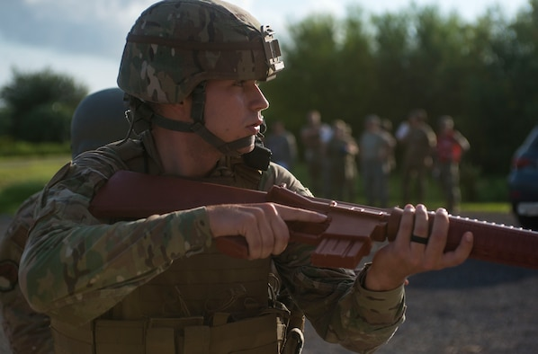 U.S. Air Force Senior Airman Weston Super, a 6th Security Forces Squadron entry controller, readies his training weapon during an active shooter exercise at MacDill Air Force Base, Fla., Aug. 8, 2019.