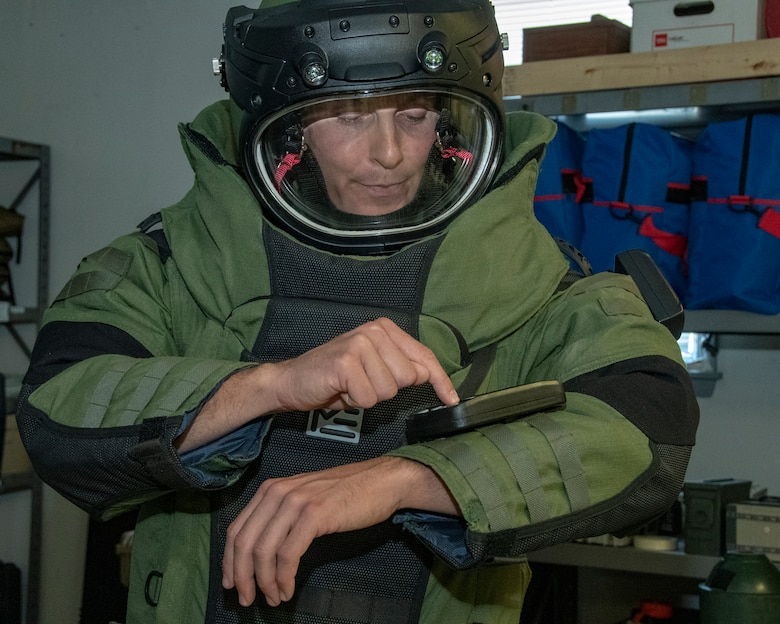 MSgt Mark Jurakovich from the 166th Airlift Wing Explosive Ordinance Disposal Unit, Delaware Air National Guard and the Outstanding Airman of the Year in the category of Senior Noncommissioned officer function tests the EOD bomb suit, Jun 6, 2019. OAY is an ANG command chief program to recognize the best of the best Airman throughout the ANG enterprise. (U.S. Air National Guard photo by Master Sgt. David J. Fenner)