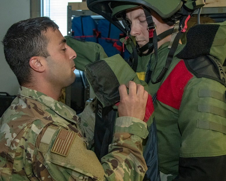 MSgt Mark Jurakovich from the 166th Airlift Wing Explosive Ordinance Disposal Unit, Delaware Air National Guard and the Outstanding Airman of the Year in the category of Senior Noncommissioned officer gets assistance with EOD bomb suit, Jun 6, 2019. OAY is an ANG command chief program to recognize the best of the best Airman throughout the ANG enterprise. (U.S. Air National Guard photo by Master Sgt. David J. Fenner)