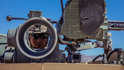 U.S. Marine Corps Lance Cpl. Christopher J. Kim, an infantry machine gunner with 1st Battalion, 25th Marine Regiment, 4th Marine Division, conducts a weapon maintenance check during Integrated Training Exercise 5-19 at Marine Corps Air Ground Combat Center Twentynine Palms, Calif., Aug. 12, 2019. ITX 5-19 is an essential component of the Marine Forces Reserve's training and readiness cycle. It serves as the principle exercise for assessing a unit's capabilities. (U.S. Marine Corps photo by Lance Cpl. Jose Gonzalez)