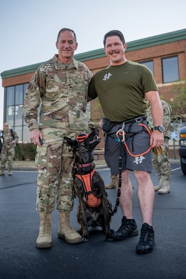 Air Force Chief of Staff Gen. David L. Goldfein meets Callie, the only search-and-rescue dog in the Department of Defense, and her handler, Master Sgt. Rudy Parsons, a pararescueman in the 123rd Special Tactics Squadron, during a tour of the Kentucky Air National Guard Base in Louisville, Ky., Aug. 10, 2019. Goldfein toured various work centers, learning about the unique mission sets of the 123rd Airlift Wing.
