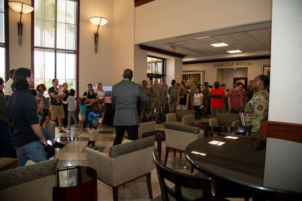 Airmen assigned to the 6th Communications Squadron and their families receive a briefing about the importance of the Davis Conference Center during an open house at MacDill Air Force Base, Fla., August 9, 2019.