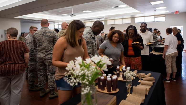 Airmen assigned to the 6th Communications Squadron and their family member's line up to eat at the Chapel following an open house at MacDill Air Force Base, Fla., August 9, 2019.