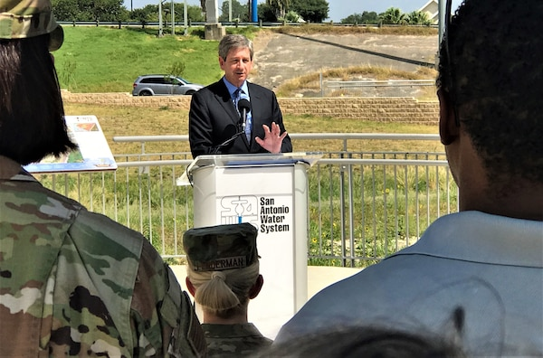 Mark Correll, deputy assistant secretary of the Air Force for Environment, Safety, and Infrastructure, addresses the audience at a groundbreaking ceremony attended by Brig. Gen. Laura Lenderman, commander of the 502nd Air Base Wing and Joint Base San Antonio, and City of San Antonio and other elected officials Aug. 7 at a park adjacent to the base. The ceremony marked the start of a sewer pipeline project by San Antonio Water System to improve service for more than 500,000 people, including Airmen and civilians working and living on JBSA-Lackland.