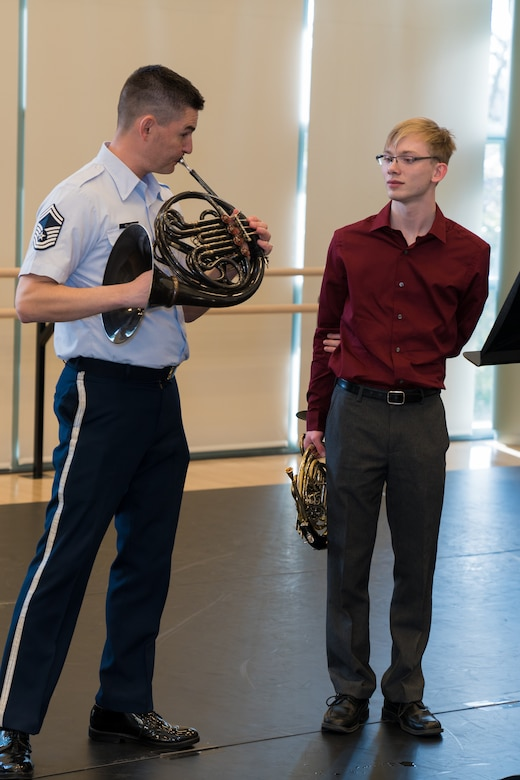 Andrew Stump (right) learns performance techniques from U.S. Air Force Band French hornist, Senior Master Sgt. Brett Miller, during The U.S. Air Force Band's 2019 Collegiate Symposium at the Rachel M. Schlesinger Concert Hall and Arts Center in Alexandria, Virginia. Stump, son of U.S. Air Force Band clarinetist Senior Master Sgt. David Stump, had the privilege of performing with the U.S. Air Force Concert Band as part of the symposium. (U.S. Air Force Photo by TSgt Valentine Lukashuk)
