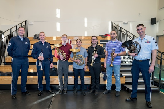 French horn student, Andrew Stump (third from left), poses with other brass instrumentalists during a rehearsal break at the Rachel M. Schlesinger Concert Hall and Arts Center in Alexandria, Virginia. The rehearsal was part of The U.S. Air Force Band's 2019 Collegiate Symposium, which afforded Stump and his father, clarinetist Senior Master Sgt. David Stump, the unique opportunity to perform together on stage for the final concert on Saturday, Feb. 2, 2019. (U.S. Air Force Photo by MSgt Brandon Chaney)
