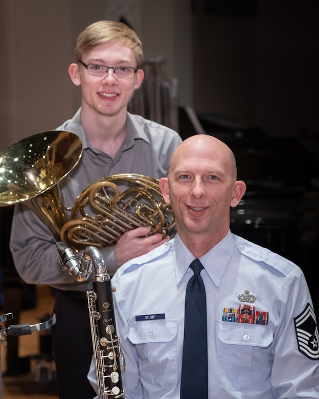 U.S. Air Force Band clarinetist, Senior Master Sgt. David Stump, poses with his son, Andrew Stump, during a rehearsal break on Joint Base Anacostia-Bolling. The rehearsal was part of the 2019 Collegiate Symposium, and it afforded the father and son a unique opportunity to perform together on Saturday, Feb. 4, 2019, at the Rachel M. Schlesinger Concert Hall and Arts Center in Alexandria, Virginia. (U.S. Air Force Photo by MSgt Brandon Chaney)