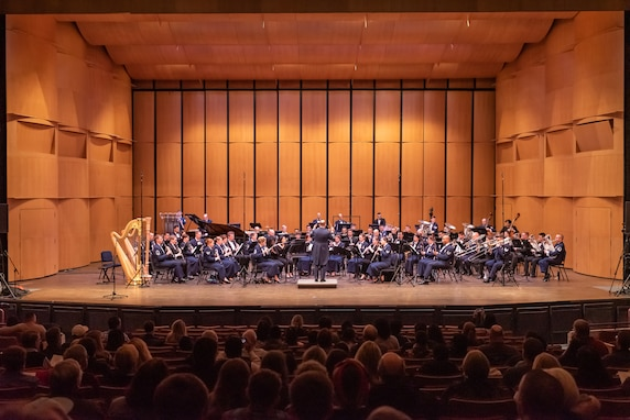 Col. Don Schofield conducts an ensemble consisting of The U.S. Air Force Concert Band and college students who were selected to perform for the 2019 Collegiate Symposium. The concert took place at the Rachel M. Schlesinger Concert Hall and Arts Center in Alexandria, Virginia, on Saturday, Feb. 2, 2019. (U.S. Air Force Photo by Master Sgt. Brandon Chaney)