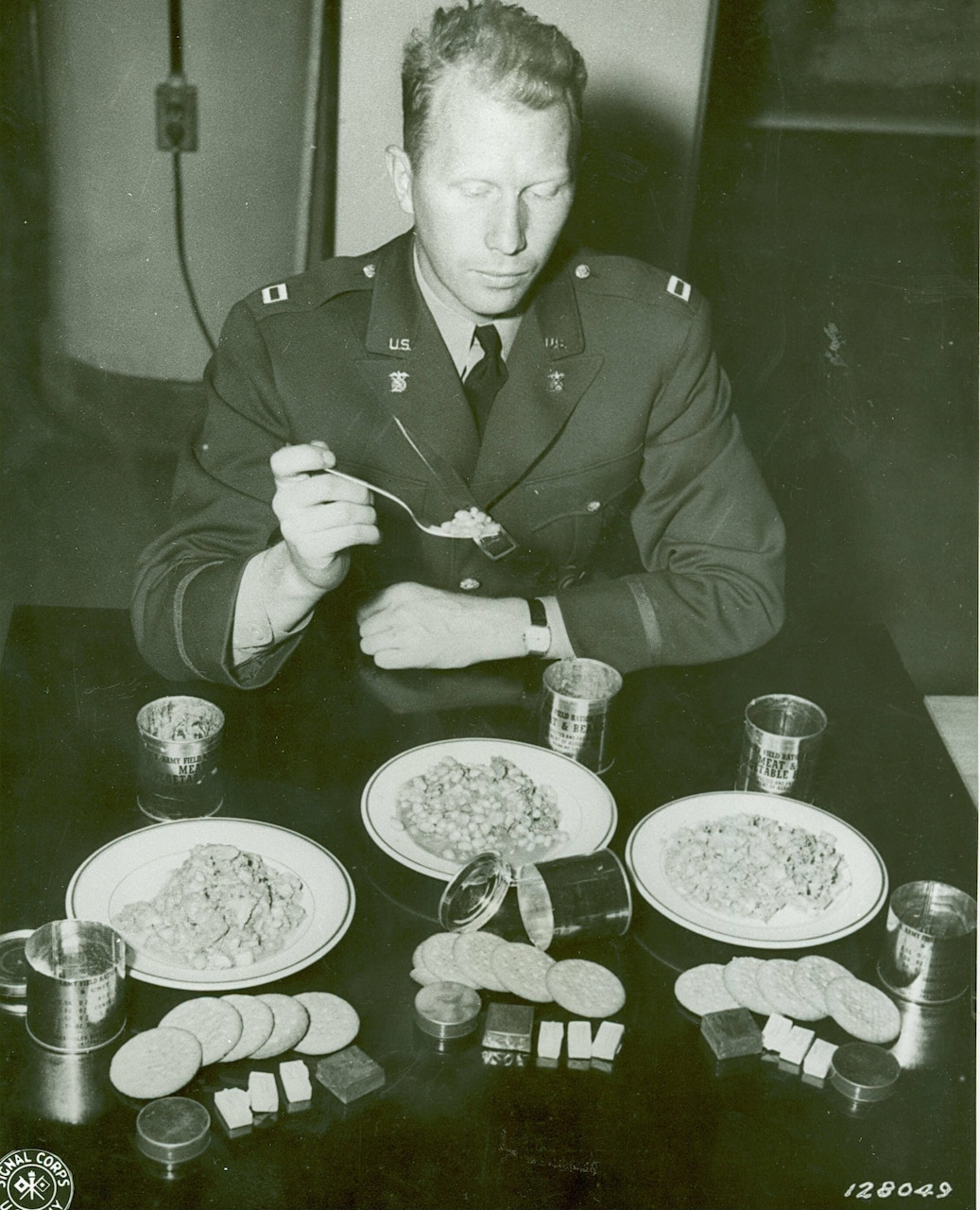 A soldier eats food.