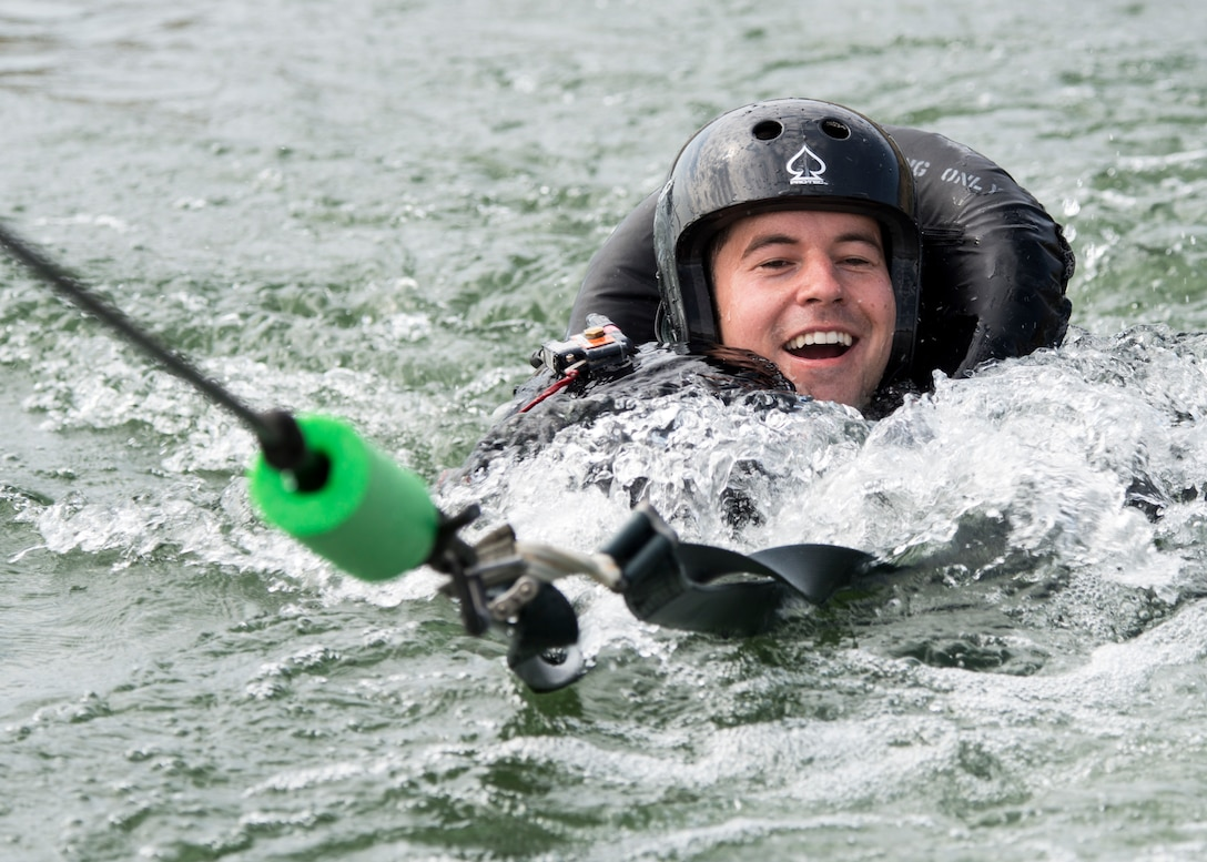 A 389th Fighter Squadron aircrew member is dragged behind a boat during water survival training Aug. 06, 2019, at C.J. Strike Reservoir, Idaho. This portion of the training allows pilots to practice unhooking the parachute from the safety harness as they are dragged by the wind. (U.S. Air Force photo by Airman Antwain L. Hanks)