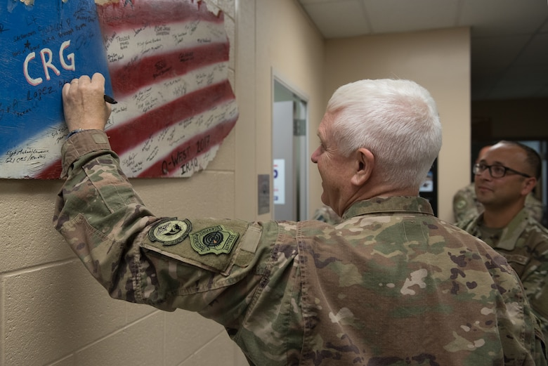 Lt. Gen. L. Scott Rice, director of the Air National Guard, signs a plaque in the shape of Kentucky during a tour of the 123rd Contingency Response Group while visiting the Kentucky Air National Guard Base in Louisville, Ky., Aug. 10, 2019. The unit is the only contingency response group in the Air National Guard. (U.S. Air National Guard photo by Dale Greer)