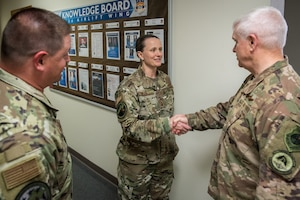 Lt. Gen. Scott L. Rice, director of the Air National Guard, speaks with Chief Master Sgt. Andrea Mizzell of the 123rd Communications Squadron during a tour of the Kentucky Air National Guard Base in Louisville, Ky. Aug. 10, 2019. Rice also conducted a town hall meeting and answered questions posed by Kentucky Air Guardsmen. (U.S. Air National Guard photo by Dale Greer)