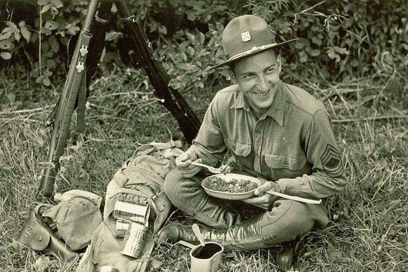 A soldier eats C-Rations.