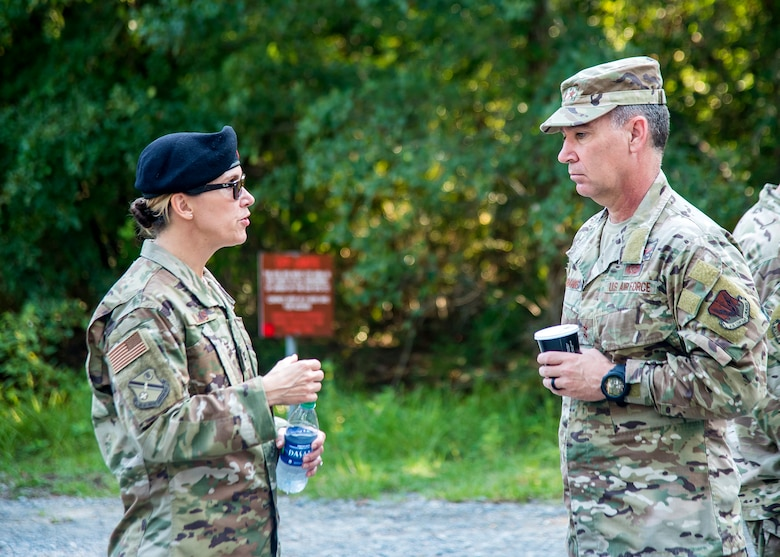 U.S. Air Force Col. Danielle Willis, left, 93d Air Ground Operations Wing vice commander, speaks with Maj. Gen. Chad Franks, Ninth Air Force commander, Aug. 9, 2019, at Moody Air Force Base, Ga. Franks, who on separate occasions served as the commander for the 23d Wing and 347th Rescue Group, is a command pilot with more than 3,300 hours in multiple aircraft including HC-130J Combat King II and HH-60G Pave Hawk. (U.S. Air Force photo by Airman 1st Class Eugene Oliver)