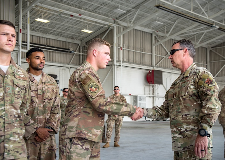 Maj. General Chad Franks, right, Ninth Air Force commander, coins an Airman from the 820th Base Defense Group Aug. 9, 2019, at Moody Air Force Base, Ga. Franks, who on separate occasions served as the commander for the 23d Wing and 347th Rescue Group, is a command pilot with more than 3,300 hours in multiple aircraft including HC-130J Combat King II and HH-60G Pave Hawk. (U.S. Air Force photo by Airman 1st Class Eugene Oliver)