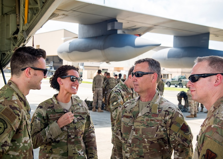 U.S. Air Force Maj. General Chad Franks, center, Ninth Air Force commander and Chief Master Sgt. Benjamin Hedden, Ninth AF Command Chief, speak with Airmen from the 71st Rescue Squadron at Moody Air Force Base, Ga., Aug. 9, 2019. Franks, who on separate occasions served as the commander for the 23rd Wing and 347th Rescue Group, is a command pilot with more than 3,300 hours in multiple aircraft including HC-130J Combat King II and HH-60G Pave Hawk. (U.S. Air Force photo by Airman 1st Class Eugene Oliver)