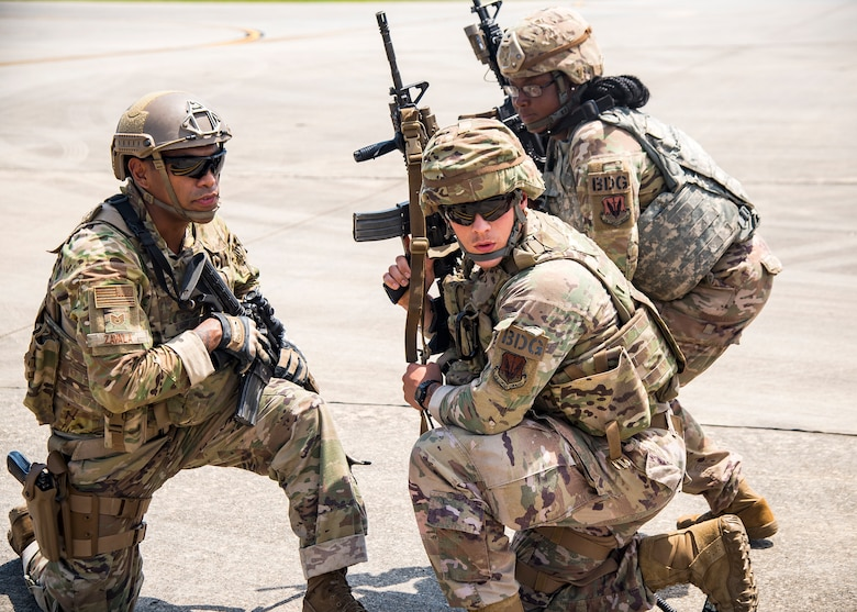 Tech. Sgt. Chris Zavala, left, 822d Base Defense Squadron (BDS) squad leader, gives command to Airmen from the 822 BDS during a tactical demonstration, Aug. 9, 2019, at Moody Air Force Base, Ga. Airmen from the 820th Base Defense Group did the tactical demo for Maj. Gen. Chad Franks, 9th Air Force commander. Franks has served on separate occasions as the commander for the 23d Wing and 347th Rescue Group and is a command pilot with more than 3,300 hours in multiple aircraft including HC-130J Combat King II and HH-60G Pave Hawk. (U.S. Air Force photo by Airman 1st Class Eugene Oliver)