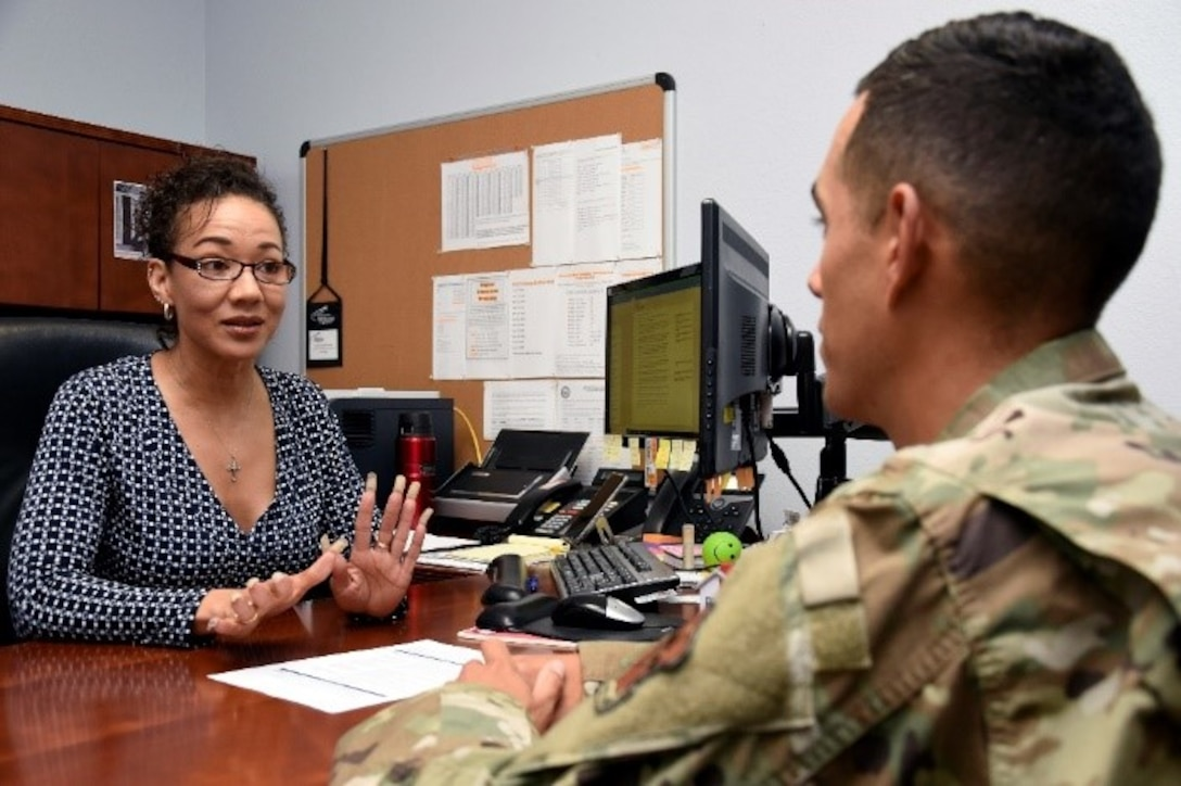 Tina Clicquot Mack, education service specialist, talks to Staff Sgt. Tyler Collins, education office formal training manager, about the SkillsBridge program offered by the education office July 29, 2019, at Luke Air Force Base, Ariz.