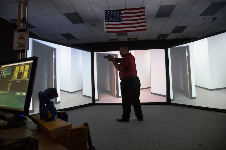 Kevin Hambrick, a civilian employer of one of 302nd Airlift Wing's Reserve Citizen Airmen, tries a scenario-based shooting simulator used by the 302nd Airlift Wing's Security Forces Squadron during the wing's annual Employer Appreciation Day at Peterson Air Force Base, Colo., Aug. 9, 2019.