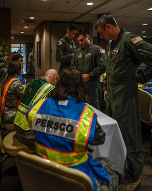 The 910th Airlift Wing's Personnel Support for Contingency Operations team, made up of 910th Force Support Squadron Reserve Citizen Airmen, simulates a deployment processing line, Aug. 11, 2019, for Youngstown Air Reserve Station's base-wide training exercise.