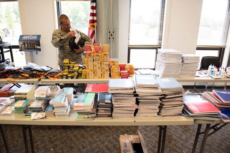 Man looks through school supplies.