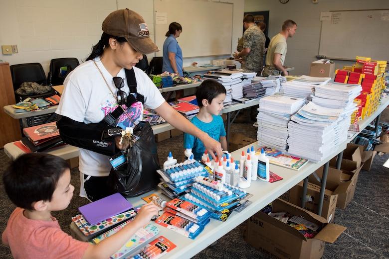 Family looks through school supplies.