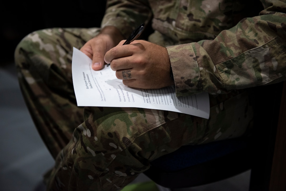 A participant fills out the after action questionnaire for the 2019 First Sergeant Symposium held in the Hoffman Auditorium at Moody Air Force Base, Aug. 7-9, 2019. The symposium provided leaders with a better understanding of the roles and responsibilities of a first sergeant. (U.S. Air Force photo 2nd Lt. Kaylin P. Hankerson)