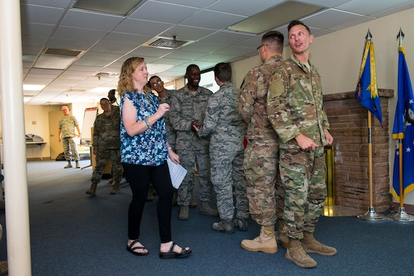 Mrs. Jamie Ellis, 926th Wing Director of Psychological Health, gives an overview to Reserve Citizen Airmen assigned to the 555th RED HORSE Squadron before they participate in a game of telephone Aug. 3, 2019 at Nellis Air Force Base, Nevada, to display how messages can be lost in translation as it is passed to each receiver. Part of the hour-long resiliency event centered on communicating good news – how do you share it and how do you receive it. (U.S. Air Force photo by Senior Airman Brett Clashman)