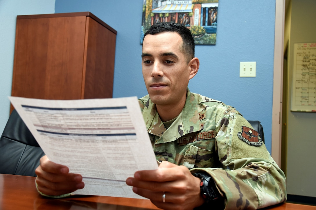 Staff Sgt. Tyler Collins, education office formal training manager, reads over the SkillsBridge vetting checklist to educate civilian companies about what the program entails July 29, 2019, at the Luke Air Force Base, Ariz.