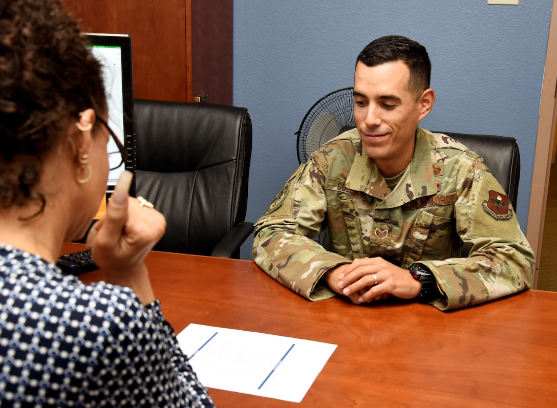 Staff Sgt. Tyler Collins, Education Office formal training manager, learns about the SkillsBridge program from Tina Clicquot Mack, education service specialist July 29, 2019, at Luke Air Force Base, Ariz.