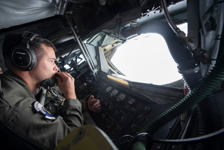 U.S. Air Force Staff Sgt. Andrew Liddane, 909th Air Refueling Squadron boom operator, prepares for in-flight refueling during RED FLAG-Alaska 19-3 at Eielson Air Force Base, Alaska, Aug. 7, 2019.