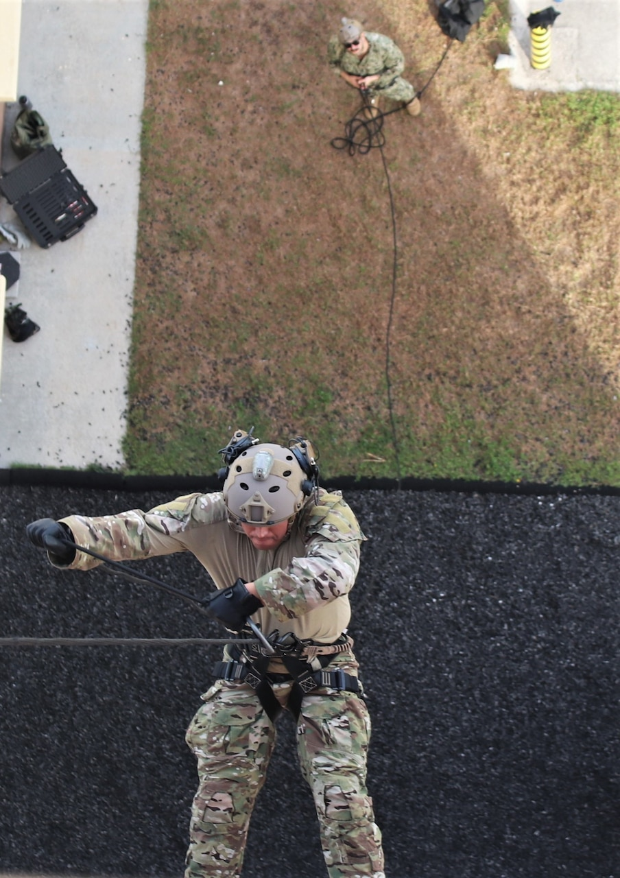 NAVAL BASE GUAM (April 15, 2019) A Sailor assigned to Explosive Ordnance Disposal Mobile Unit (EODMU) 5, rappels down a building during the Tower Operations portion of the Naval Helicopter Rope Suspension Technique (HRST) course. EODMU-5 is assigned to Commander, Navy Expeditionary Forces Pacific, the primary expeditionary task force responsible for the planning and execution of coastal riverine operations, explosive ordnance disposal, diving engineering and construction, and underwater construction in the U.S. 7th Fleet area of operations.