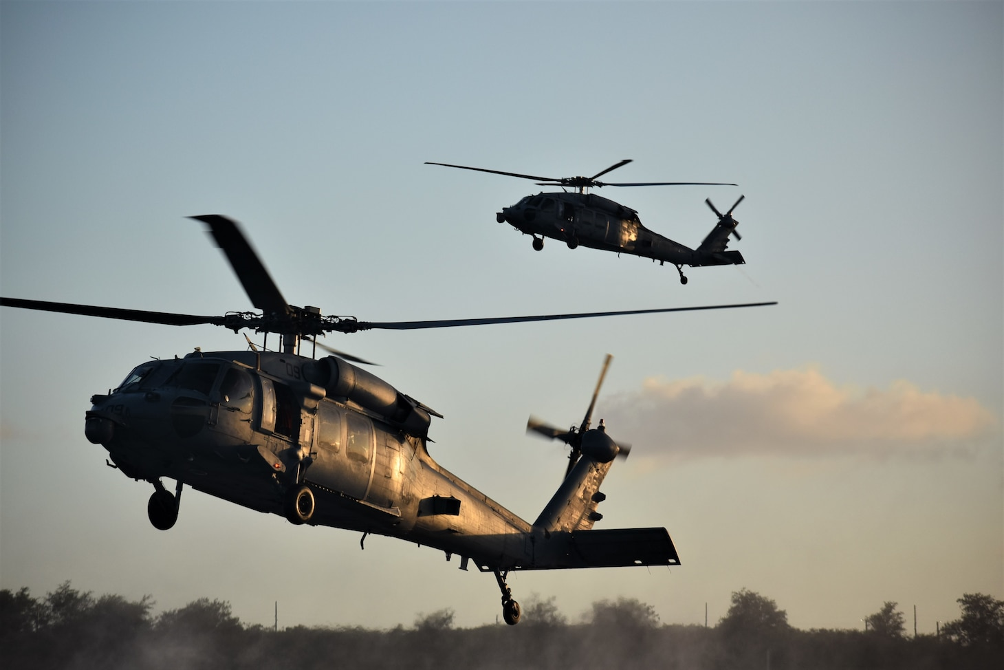 NAVAL BASE GUAM (April 16, 2019) Two MH-60S Seahawk helicopters, attached to Helicopter Sea Combat Squadron (HSC) 25, transport Sailors assigned to Explosive Ordnance Disposal Mobile Unit (EODMU) 5, during the fast rope portion of the Naval Helicopter Rope Suspension Technique (HRST) course. EODMU-5 is assigned to Commander, Navy Expeditionary Forces Pacific, the primary expeditionary task force responsible for the planning and execution of coastal riverine operations, explosive ordnance disposal, diving engineering and construction, and underwater construction in the U.S. 7th Fleet area of operations.