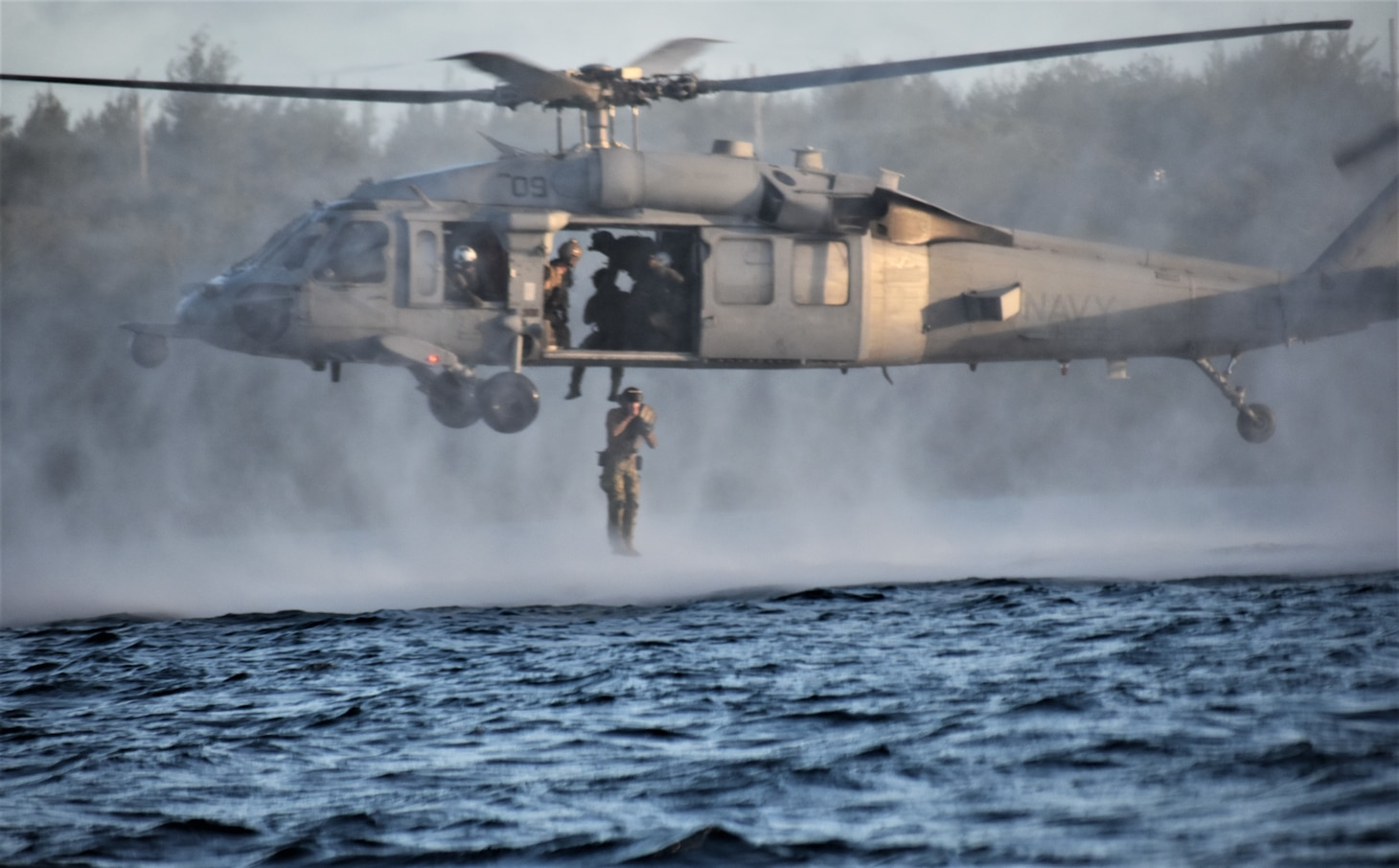 NAVAL BASE GUAM (April 15, 2019) Sailors assigned to Explosive Ordnance Disposal Mobile Unit (EODMU) 5, jump out of a MH-60S Seahawk helicopter, attached to Helicopter Sea Combat Squadron (HSC) 25, during a Cast and Recovery portion of the Naval Helicopter Rope Suspension Technique (HRST) course. EODMU-5 is assigned to Commander, Navy Expeditionary Forces Pacific, the primary expeditionary task force responsible for the planning and execution of coastal riverine operations, explosive ordnance disposal, diving engineering and construction, and underwater construction in the U.S. 7th Fleet area of operations.
