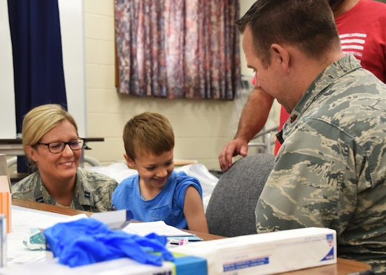 Airmen from the 179th Airlift Wing Medical Group, Mansfield, Ohio, give a child immunization shots as part of GuardCare Weekend Aug. 10, 2019, at the Buckeye Career Center, New Philadelphia, Ohio. GuardCare offers the opportunity for community members to receive basic healthcare and advice on further medical recommendations.