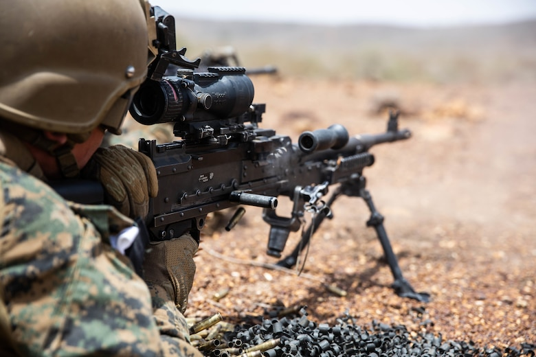 A U.S. Marine with Special Purpose Marine Air-Ground Task Force-Crisis Response-Africa 19.2, Marine Forces Europe and Africa, fires an M240B machine gun during quick-reaction force training in Thiés, Senegal, Aug. 5, 2019. The rehearsal increased the Marines' ability to conduct link-up procedures, on scene and in-route trauma stabilization, and offensive and defensive operations. SPMAGTF-CR-AF is deployed to conduct crisis-response and theater-security operations in Africa and promote regional stability by conducting military-to-military training exercises throughout Europe and Africa.