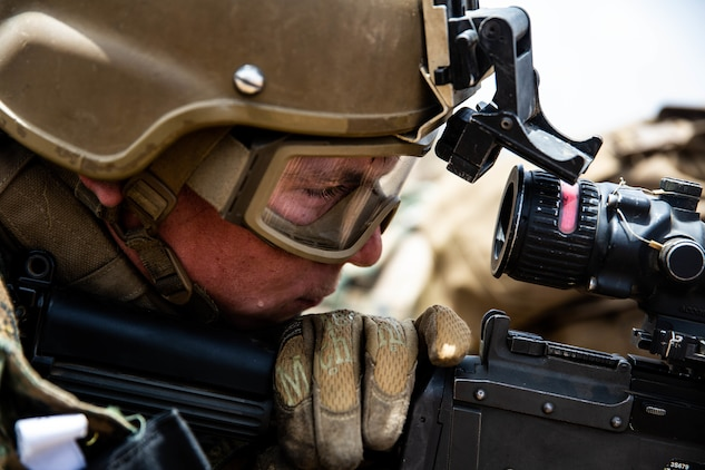 A U.S. Marine with Special Purpose Marine Air-Ground Task Force-Crisis Response-Africa 19.2, Marine Forces Europe and Africa, prepares to fire an M240B machine gun during quick-reaction force training in Thiés, Senegal, Aug. 5, 2019. The rehearsal increased the Marines' ability to conduct link-up procedures, on scene and in-route trauma stabilization, and offensive and defensive operations. SPMAGTF-CR-AF is deployed to conduct crisis-response and theater-security operations in Africa and promote regional stability by conducting military-to-military training exercises throughout Europe and Africa. (U.S. Marine Corps photo by Cpl. Margaret Gale)