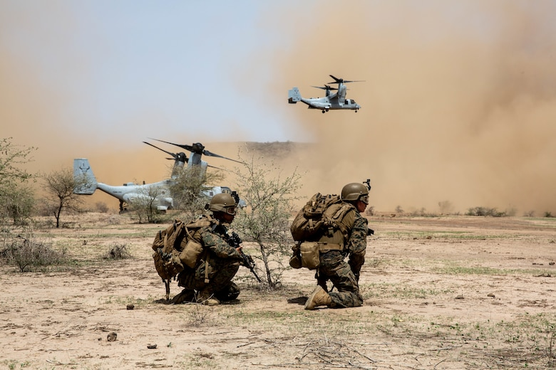 U.S. Marines with Special Purpose Marine Air-Ground Task Force-Crisis Response-Africa 19.2, Marine Forces Europe and Africa, prepare to extract from a landing zone during a quick response force, full mission profile rehearsal in Thiés, Senegal, Aug. 5, 2019. The rehearsal increased the Marines' ability to conduct link-up procedures, on scene and in-route trauma stabilization, and offensive and defensive operations. SPMAGTF-CR-AF is deployed to conduct crisis-response and theater-security operations in Africa and promote regional stability by conducting military-to-military training exercises throughout Europe and Africa. (U.S. Marine Corps photo by Cpl. Margaret Gale)