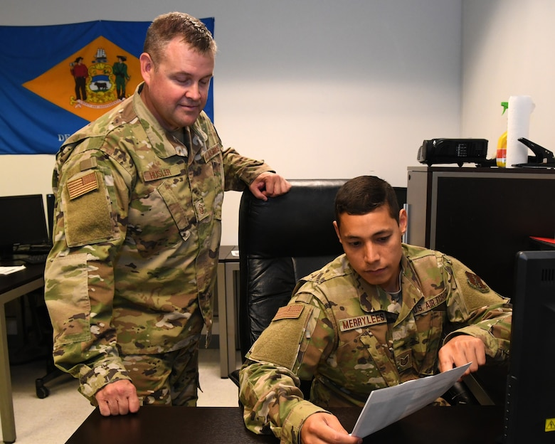 U.S. Air Force Technical Sgt. Andrew C. Merrylees, a radio frequency transmission system specialist from the 166th Airlift Wing, Delaware Air National Guard, shows a fellow Airman a computer program in New Castle, Delaware, June 6, 2019. Merrylees was recognized as the Air National Guard's 2019 Outstanding Noncommissioned Officer of the Year and one of the Air Force's 12 Outstanding Airmen of the Year for his innovative ideas in how to improve ANG cyberspace. (U.S. Air National Guard photo by Master Sgt. David J. Fenner)
